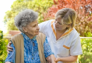 Carer helping elderly lady